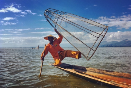 Posing fisher man on Inle Lake.