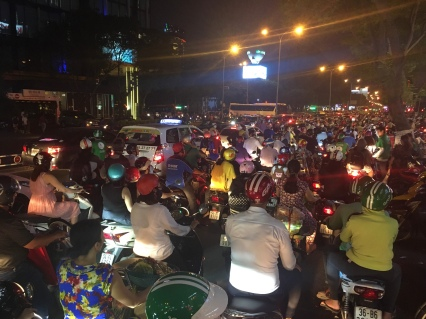 Street chaos in Saigon (Ho-Chi-Minh-City/HCMC) – you gotta dive into it and arrange yourself!