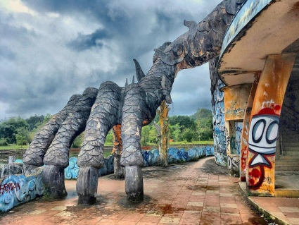 This giant hand belongs to the gigantic dragon that is the major attraction in an abandoned water park in the Central-Vietnamese city of Hue.