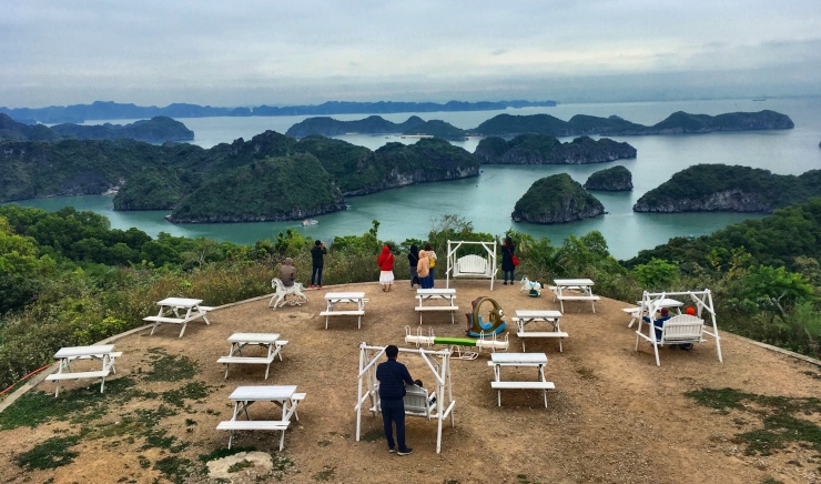 Overviewing the dozens of limestone islands at Halong Bay from Cat Ba's Cannon Fort.
