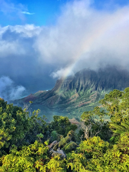 Looking down on the Na Pali Coast from the Kalalau Lookout in Kokee State Park – just in time for a rainbow before the clouds swallow everything up.